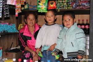 Family in shack shop, Yuksom/Yuksum, Sikkim, India