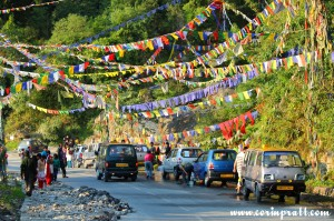 Flags, cars, people and car washing, Dussehra Hindu Festival, Gangtok, Sikkim, India