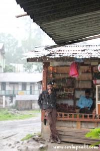 Stall owners in the rain, Yuksom, Sikkim, India