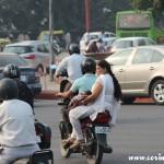 Roundabout, overloaded motorbike, baby, traffic, New Delhi