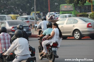 Roundabout, overloaded motorbike, baby, traffic, New Delhi