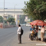 Roadside car stall, motorbike couple, New Delhi, road